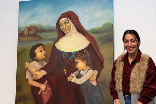 Mary MacKillop College Wakeley student Damyana Moma with her Clancy Prize artwork, The Spirit of Joy