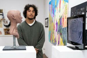 Martino Kanasugi, a former St Mary's Cathedral College Sydney student, with his Clancy Prize artwork